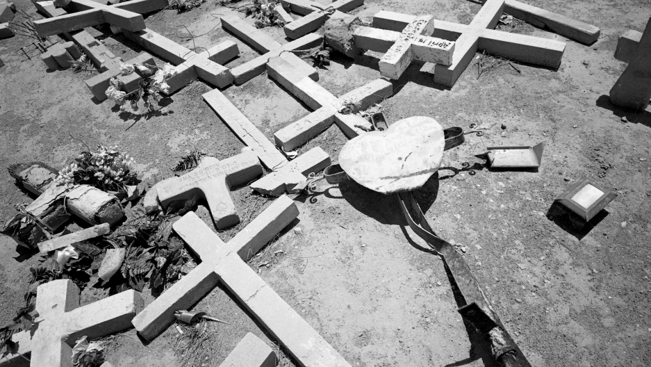 Grave stones being uprooted in a cemetery in Tucson, supposedly because cemetery fees had not been paid. Families arrived very upset, having not been told that the graves of their relatives had been uprooted, Tucson, Arizona, 1997