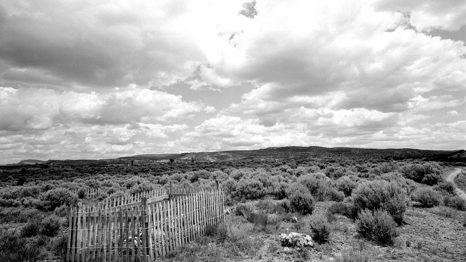 A fenced in gravesite in the open landscape of South Dakota, 1997