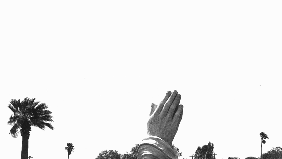 Monument of praying hands in a cemetery in Corpus Christi, Texas, 1997