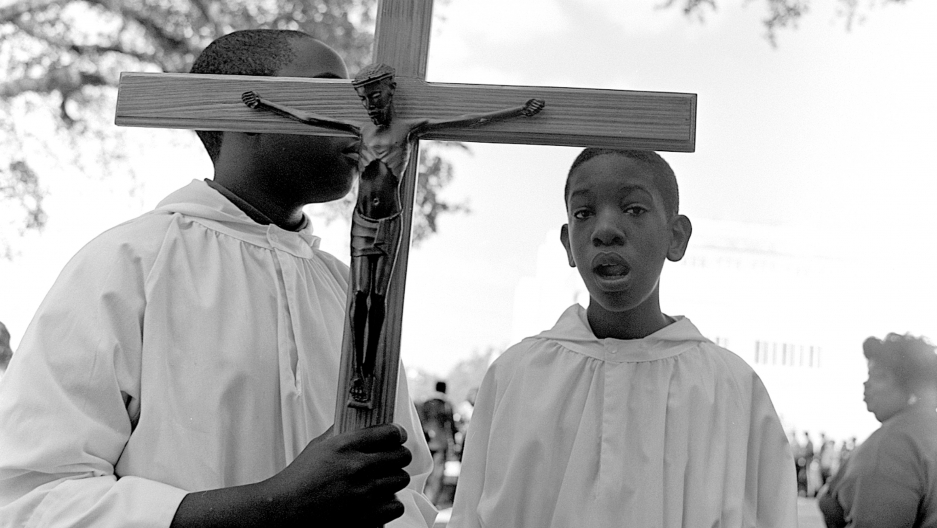 Altar boys carrying a crucifix in a funeral procession,Baton Rouge, Louisiana, 1998