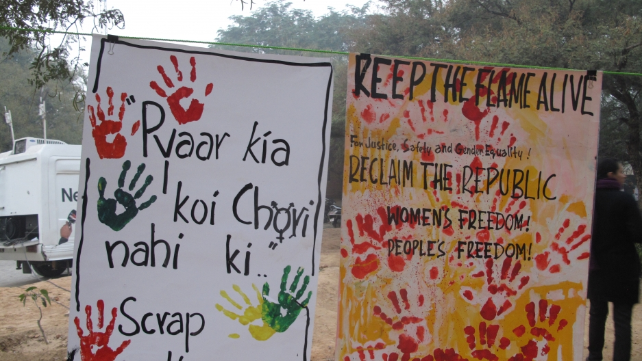 Posters at the New Delhi rally on the anniversary of the gang rape