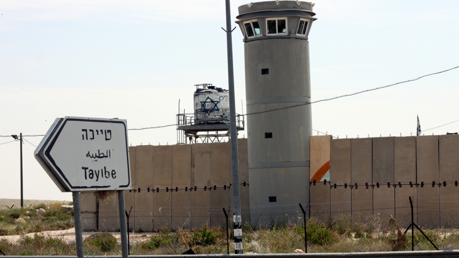An Israeli military post sits at the beginning of the road leading into the village of Taybeh.