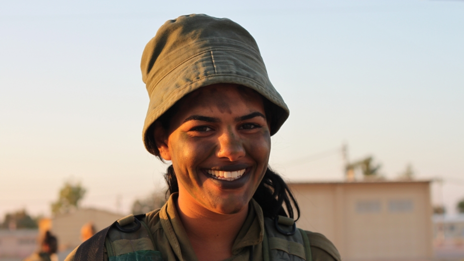 This soldier painted her lips black.
