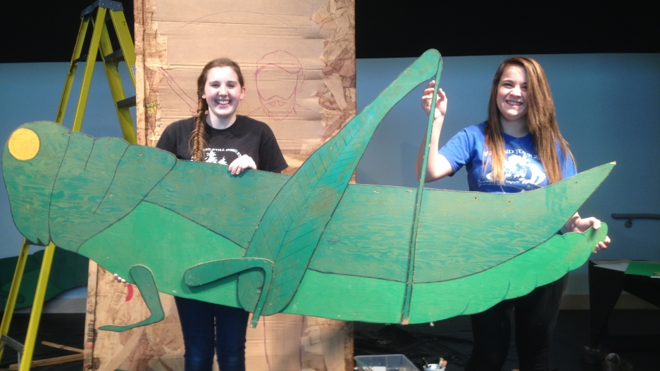Sicelia Dubbin and  Jenna Anderson hold a giant grasshopper they've made for the St. Urho's Day parade in Finland, Minneosta. The holiday that originated in northern Minnesota in the 1950s celebrates St. Urho, who allegedly saved Finland's grape crop from