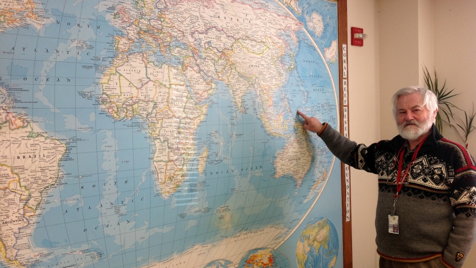 Natural Products division head David Newman points to Palau on a wall map at the National Cancer Institute in Maryland. Palau is one of numerous countries where biological samples have been collected over the past three decades in an effort to identify po