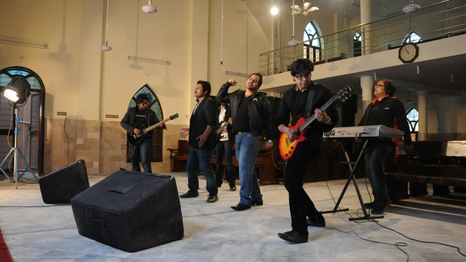 "Members of Hallelujah recording the music video for ""Rab Janay""."