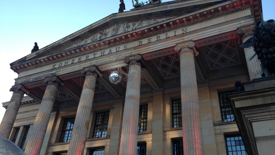 A disco ball hangs above the entrance to Konzerthaus Berlin, the city's symphony orchestra concert hall.