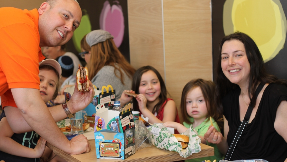 Daniel, Amy, and their kids, visiting Jerusalem from Manhattan, eat McDonalds hamburgers with the special Passover buns. The kids ate the burgers and left the Passover buns mostly untouched.