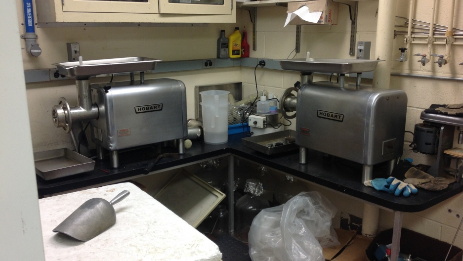 Samples from Palau and elsewhere around the world are frozen and sent to this lab at the National Cancer Institute, where they're chopped up and fed into industrial meat grinders like these.