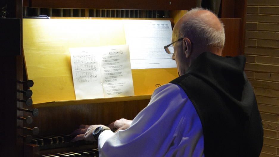 One of the monks plays the organ at St. Joseph's Abbey.