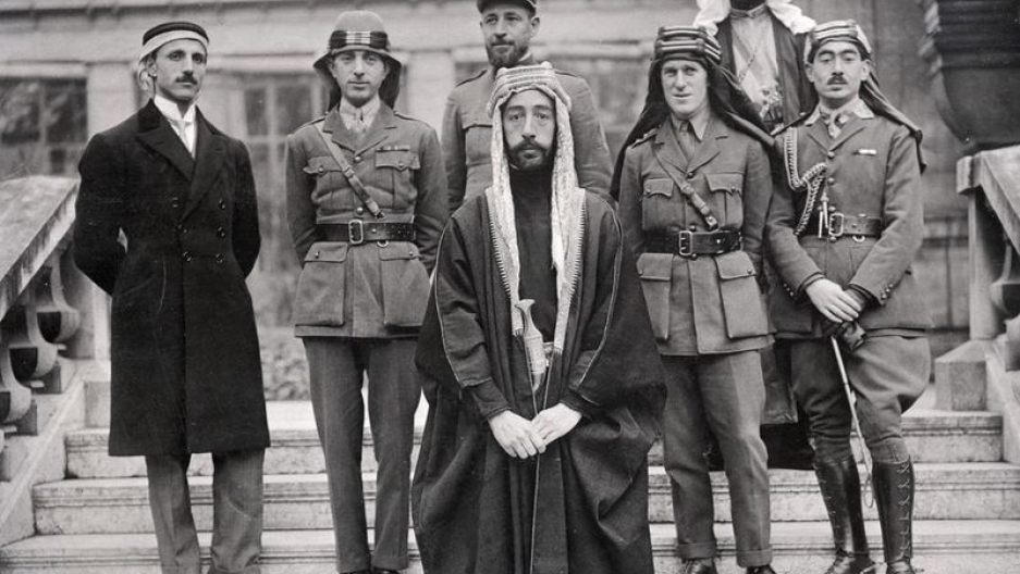 The Arab delegation at the Versailles Peace Conference, 1919. That's not Alec Guinness, that's Prince Faisal. Left to right: Rustum Haidar, Nuri as-Said, Prince Faisal (front), Captain Pisani (rear), T. E. Lawrence, Faisal's slave (name unknown), Captain