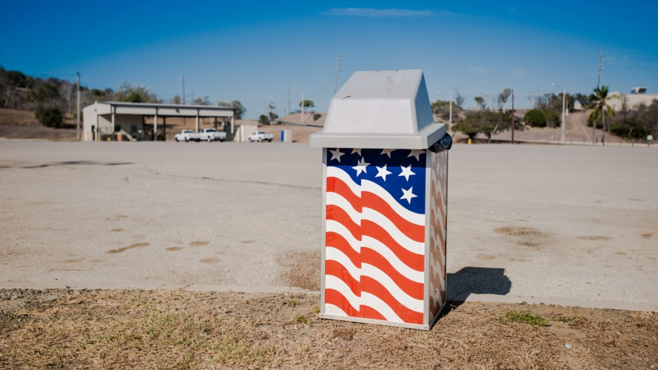 The Stars and Stripes on a Guantanamo trash can.