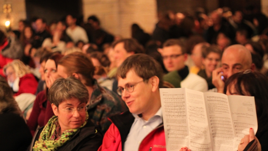 German tourists made up most of the Christians who attended midnight mass at Dormition Abbey.