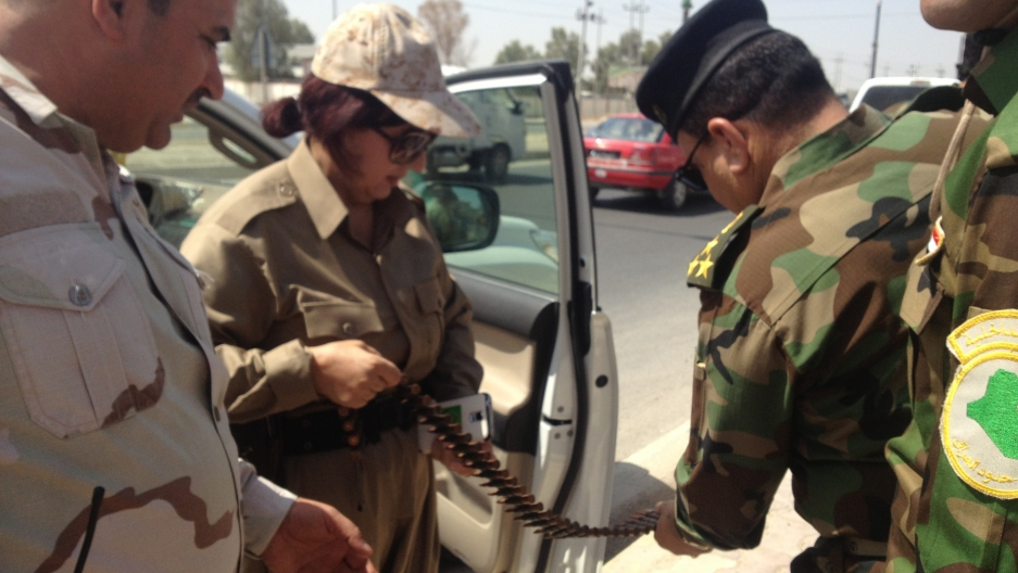 Col Nahida inspects her ammunition before hitting the road again.