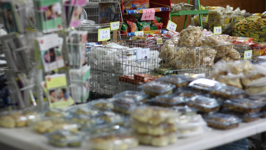 A Filipino food market in the bus station caters to the foreign worker community.