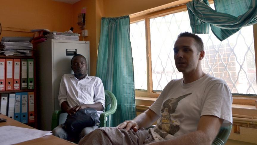 American economist Will Ruddick and Alfred Sigo in the Mombasa offices of Koru Kenya, the NGO that administers Bangla-Pesa.