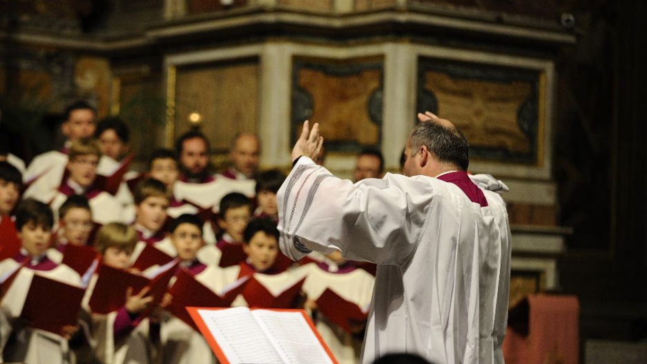 Monsignor Massimo Palombella leads the boys' choir during a concert. The Sistine Chapel Choir Director composes and arranges music for the choir.