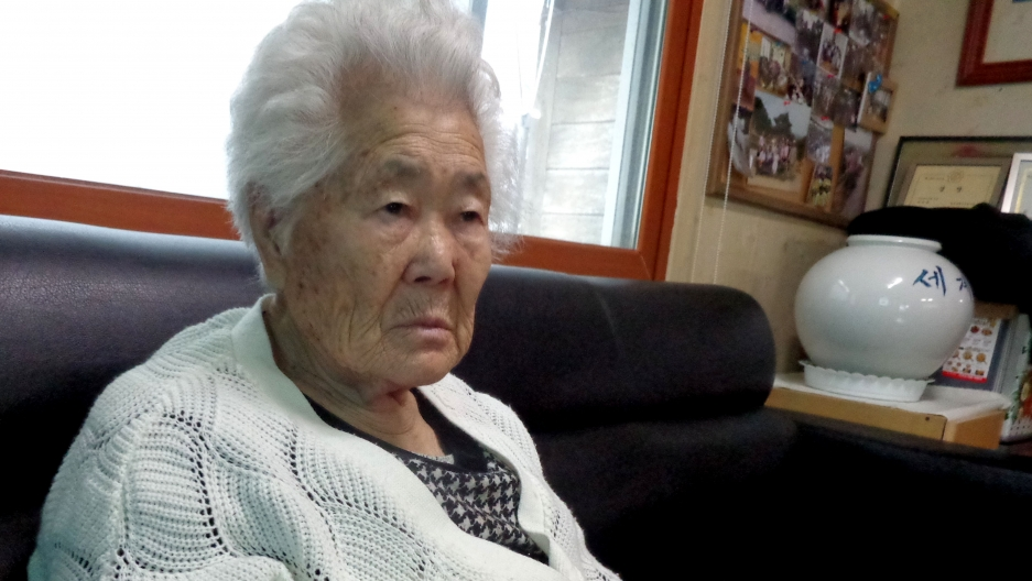 """Ok-Seon Yi says she was 15 years old when soldiers abducted her and brought to a """"comfort station,"""" or military brothel. Now ,she is 87 years old and lives in a home for the survivors outside of Seoul."""
