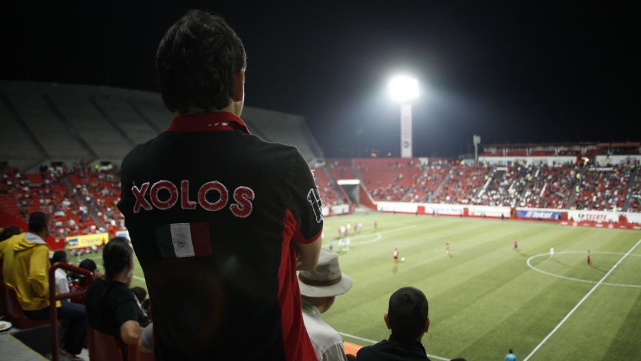A fan watches a Xolos match at Estadio Caliente in Tijuana, Mexico.