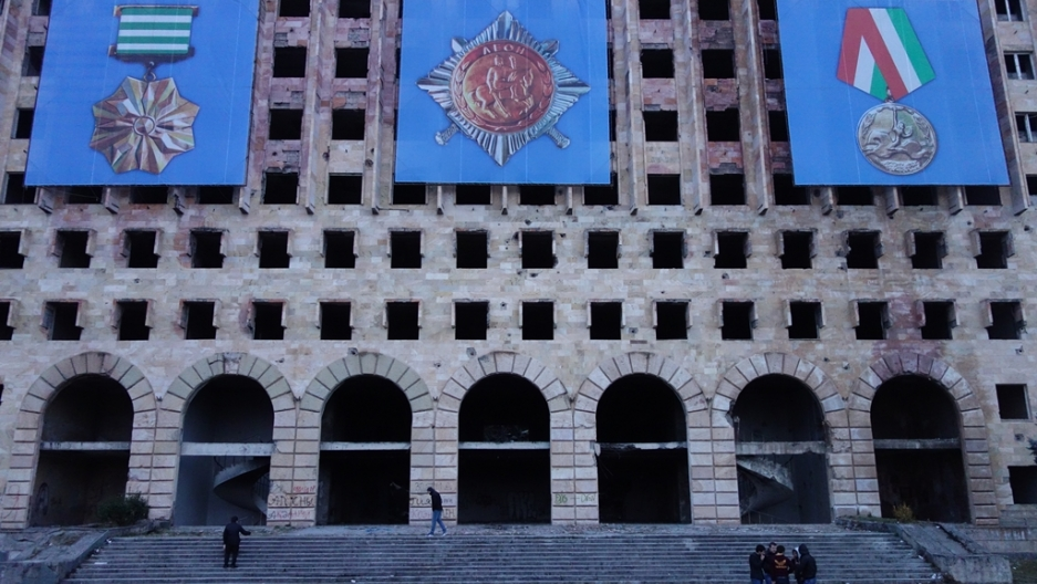 Today, the Soviet-era central government complex in Sukhumi is a burnt-out shell and a reminder of the destructive 1992-93 war of secession that killed more than 20,000 people and permanently forced more than 200,000 from their homes.
