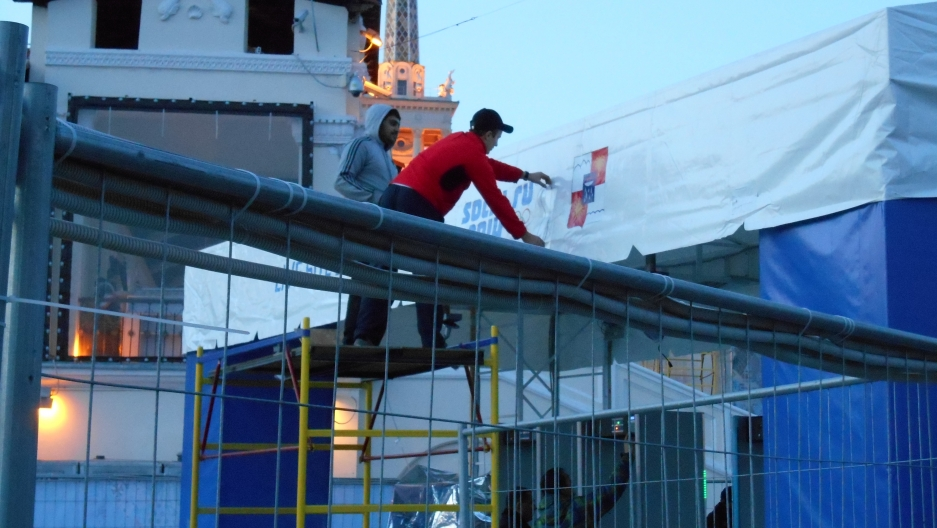 Workers putting finishing touches on one of the many live-event venues going up around Sochi.