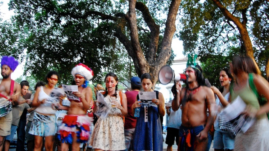 """Carnival participants sing new lyrics to traditional songs as they """"expel"""" the Rio governor from office."""