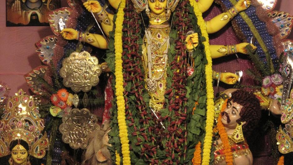 A typical depiction of Goddess Durga, showing her killing the notorious demon Mahishasura.