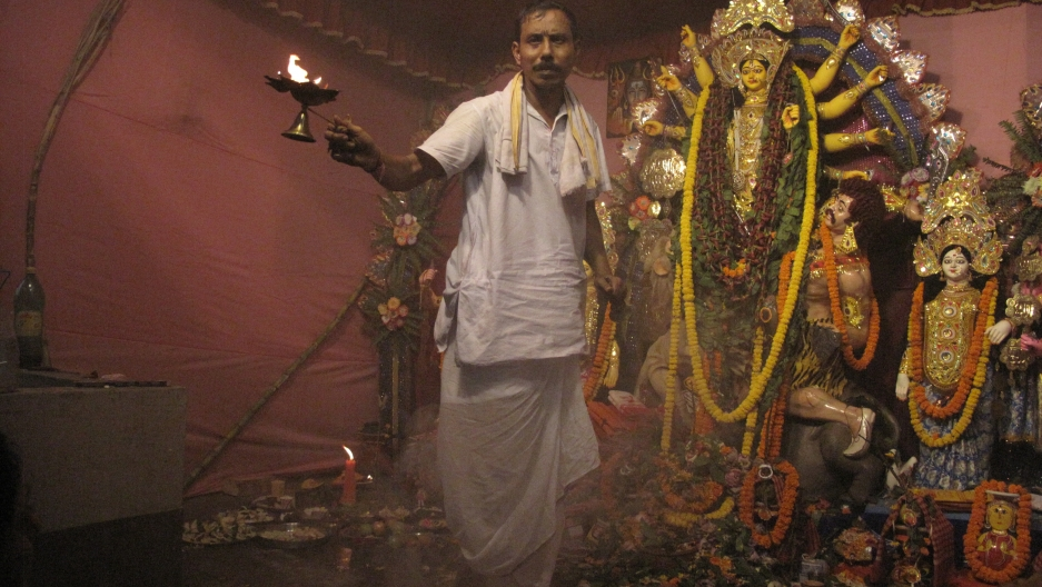 A priest worships the goddess in a ceremony in Kolkata.
