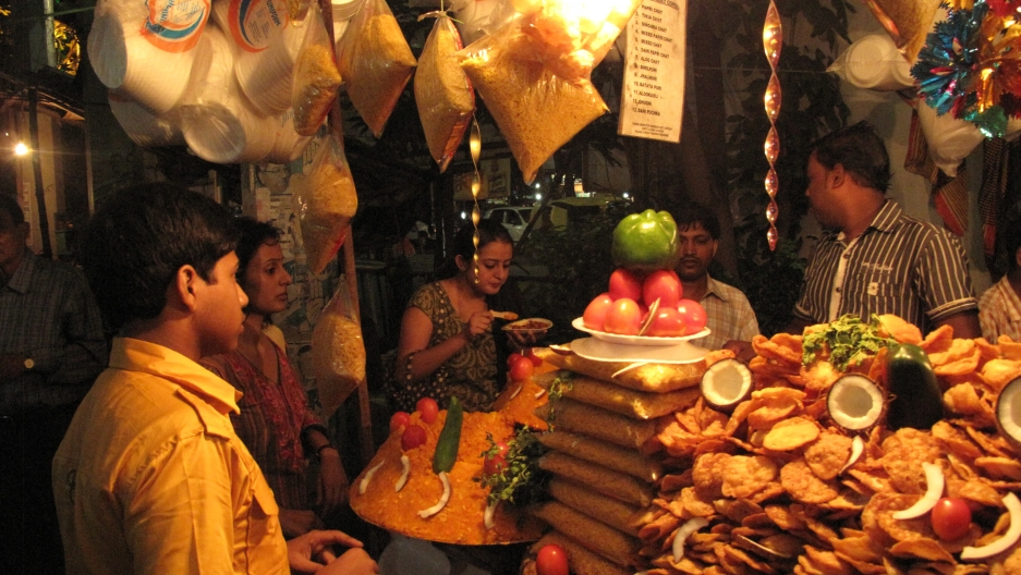 Eating street food is part of the culture of Durga Puja. People walk from neighborhood to neighborhood, stopping at roadside shops for snacks.