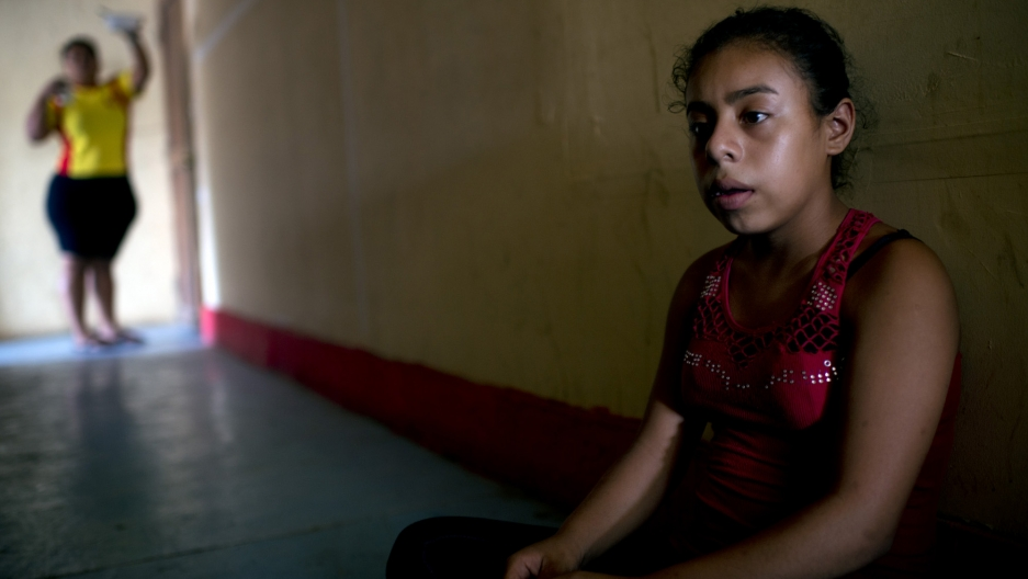 A child waits for her relatives at a migrant shelter in southern Mexico. She attempted to reach the United States with a human smuggler, but they were detained by Mexican officials.