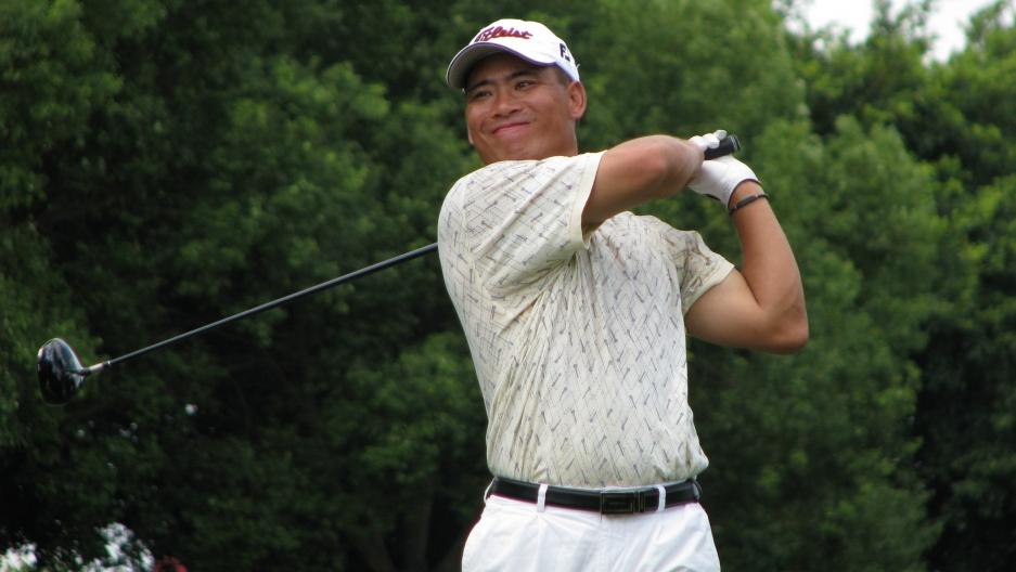 Zhou Xunshu tees off at a tournament in China