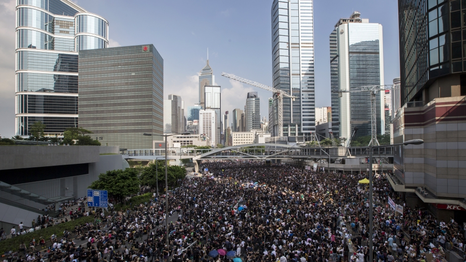 Protesters block the main road to the financial district in Hong Kong on September 29, 2014.