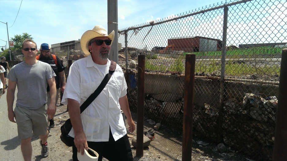 """Mitch Waxman has been leading his """"Poison Cauldron"""" tour of Newtown Creek for four years now. Here he is leading curiosity seekers through a region known as DUKBO (Down Under the Kosciuszko Bridge Onramp), an industrial neighborhood of truck-based busines"""
