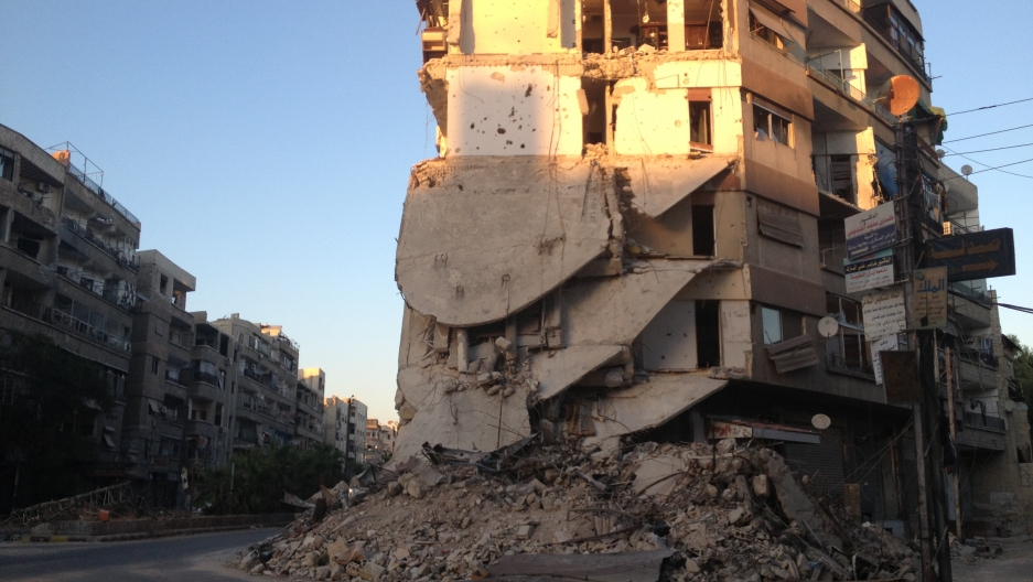 Despite the destruction of the Zamalka neighborhood, residents continue to eke out an existence.