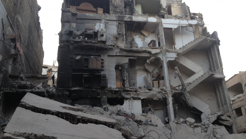 Buildings have been destroyed, people displaced and entire families killed by the fighting in the Damascus neighborhood of Zamalka.