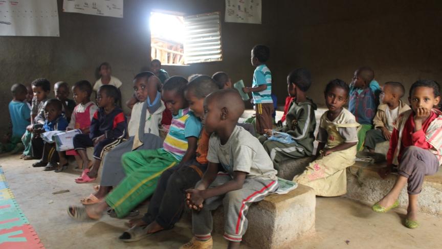 Children attend kindergarten in Awra Amba.