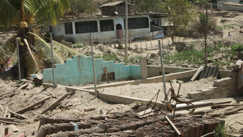 A home in Cacahuatapec is nearly completely buried by sand and debris from when the nearby river flooded.