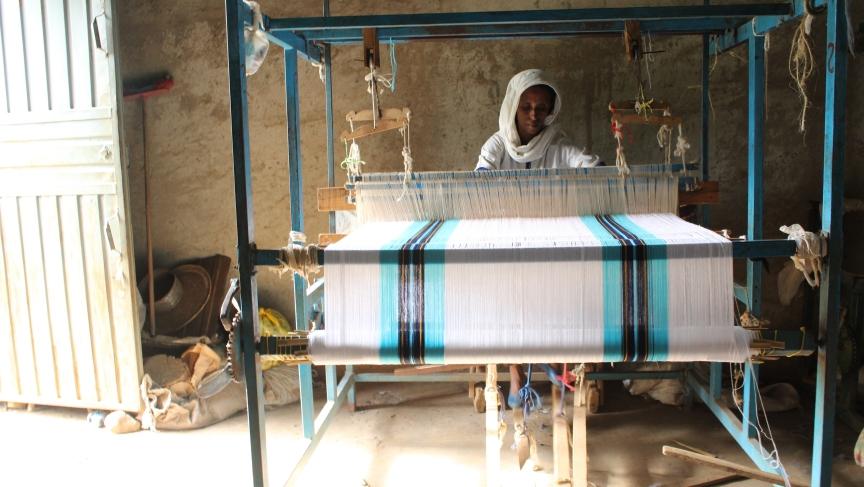 A woman at Awra Amba's weaving factory.