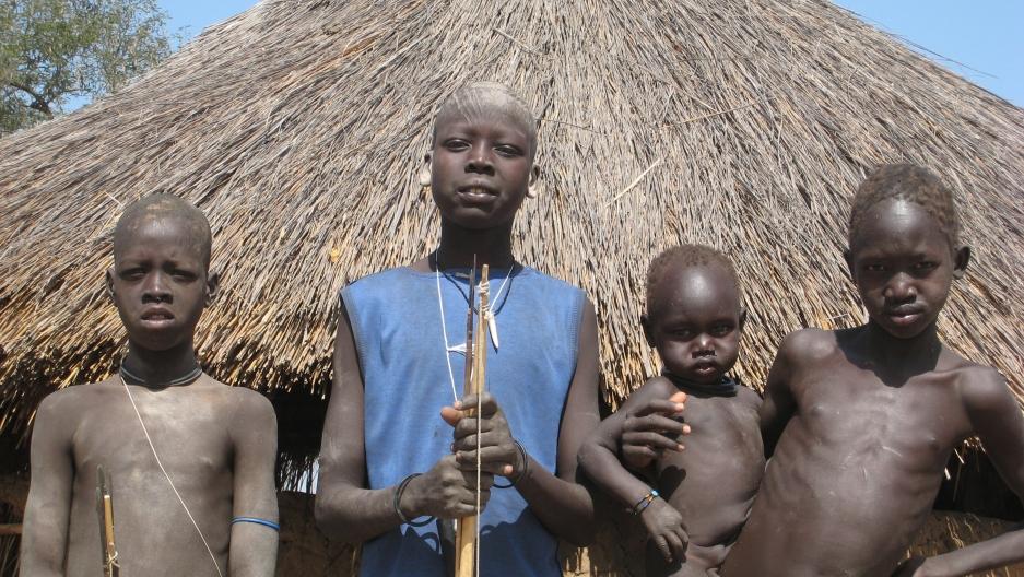 Children by their home, Lojora Village, South Sudan.