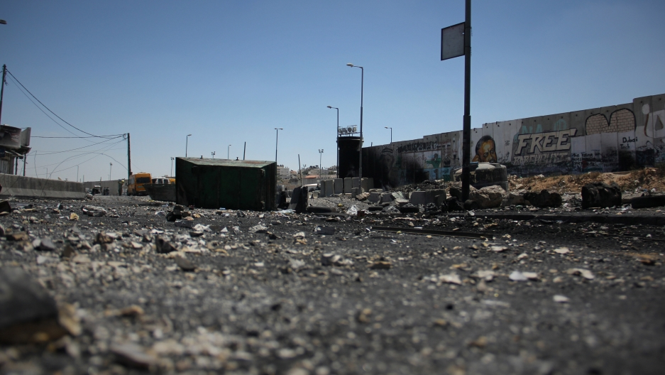 The charred Qalandiya checkpoint after clashes between protesters and the Israeli army.
