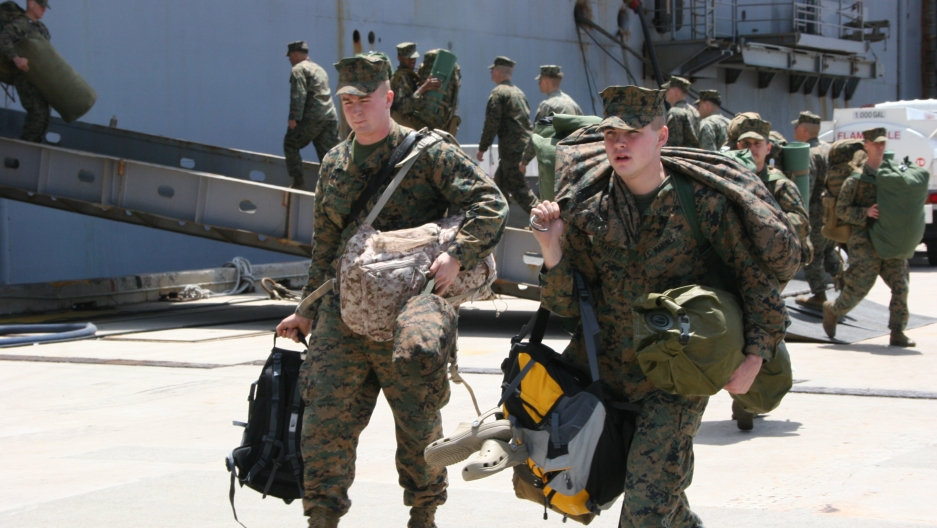 US Marines return to Okinawa after a mission to the tsunami-ravaged disaster zone in northeast Japan in 2011.