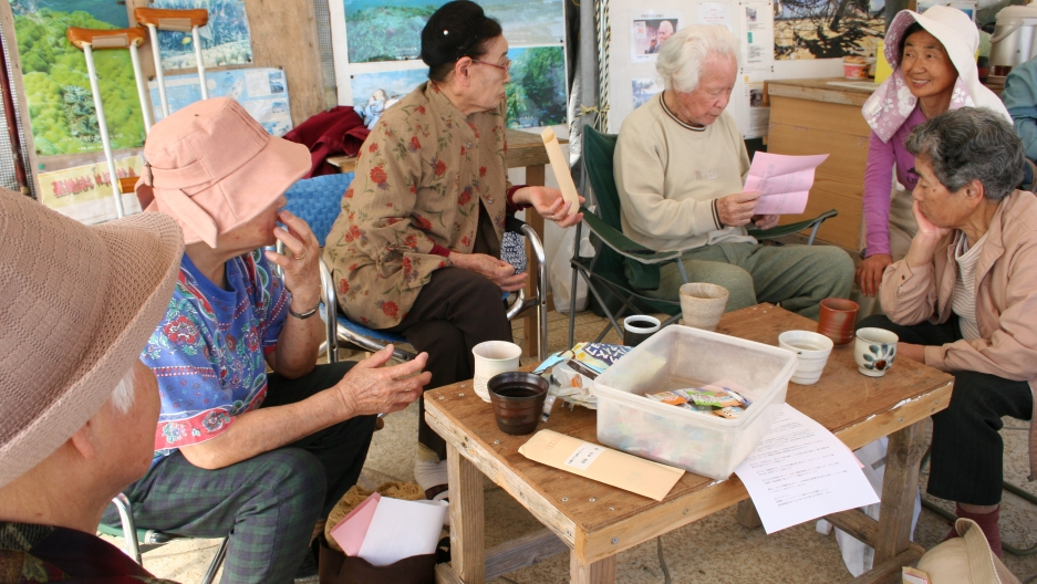 A group of elderly residents who live near the area of the base relocation have held a tent sit-in for several years across the site from the proposed military aircraft runways.