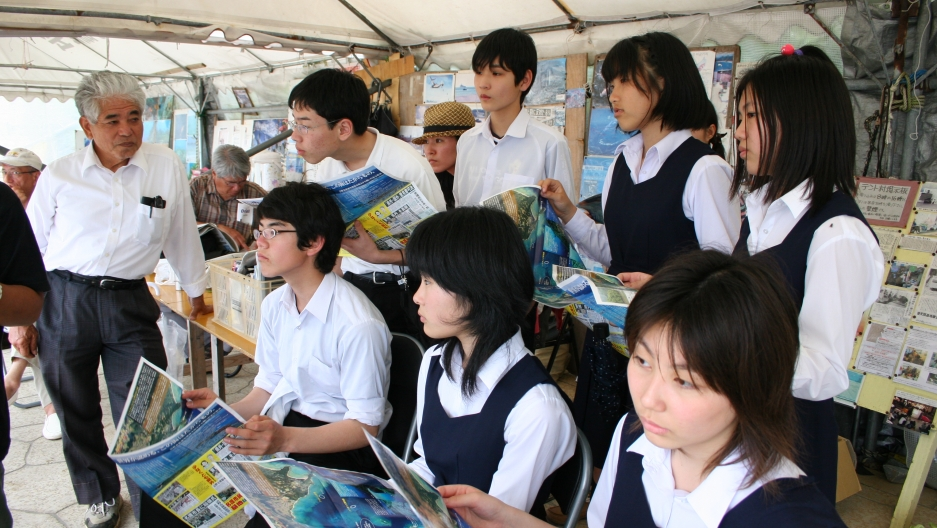 Japanese schoolchildren visit a tent set up by local Henoko residents opposed to the base relocation.
