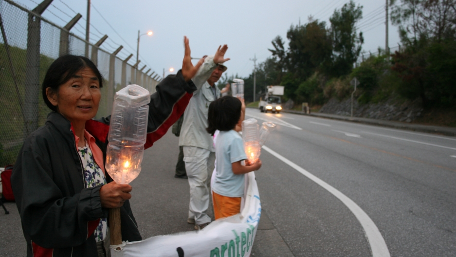 Local residents in Henoko, the site where the base will relocate, gathered with candles every Saturday evening in 2011 to protest the move.