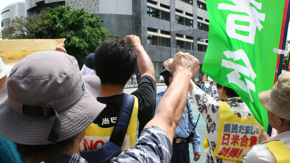 In this photo from 2011, protesters rally outside Okinawa's prefectural government office against the US military presence on the island.