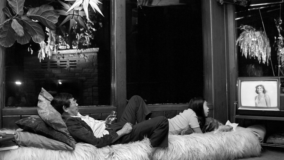 Jang's Uncle Monroe and cousin Cynthia watching TV at home in the Bay Area in the 1970s.