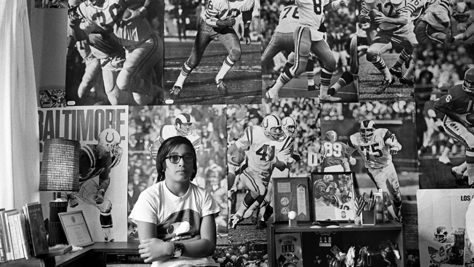Jang's cousin David in his bedroom plastered with football posters.