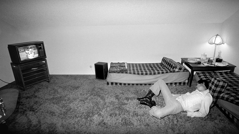 Uncle Monroe asleep on the shag carpet in front of the TV. It's part of Michael Jang's collection of family photos, The Jangs, documenting his Chinese-American family in the 1970s.