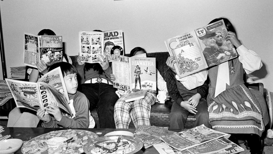 Michael Jang's cousins reading Mad magazine and comics.