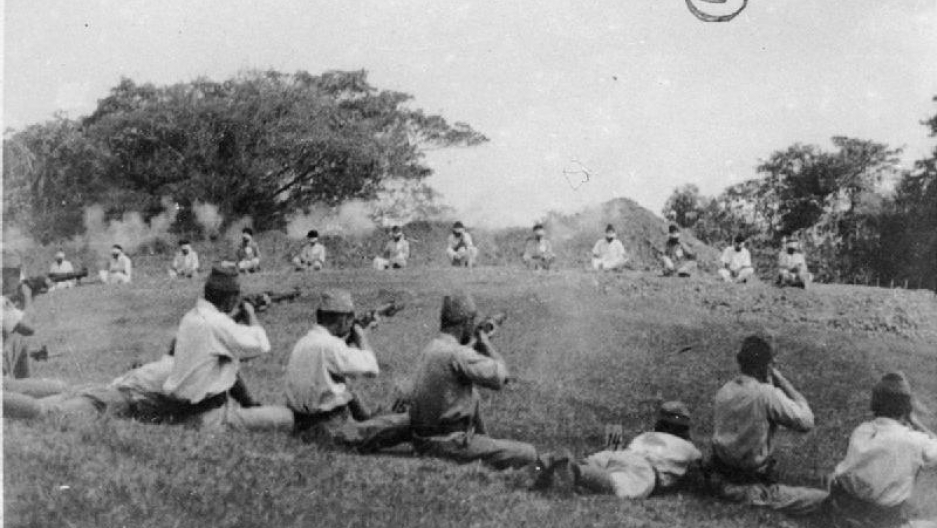 Japanese soldiers shooting Indian prisoners of war. This picture is one of four photographs of this incident found among Japanese records when British troops entered Singapore.
